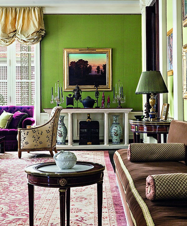 Thanks to multiple seating areas united by a large Oriental rug, the former ballroom of a Beaux-Arts mansion on Manhattan's Upper East Side — with walls done up in green, a Roberts signature — can seat groups of varying sizes.
