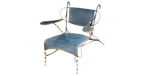 Iron and woven-cane lounge chair, 1950s, offered by J.F. Chen