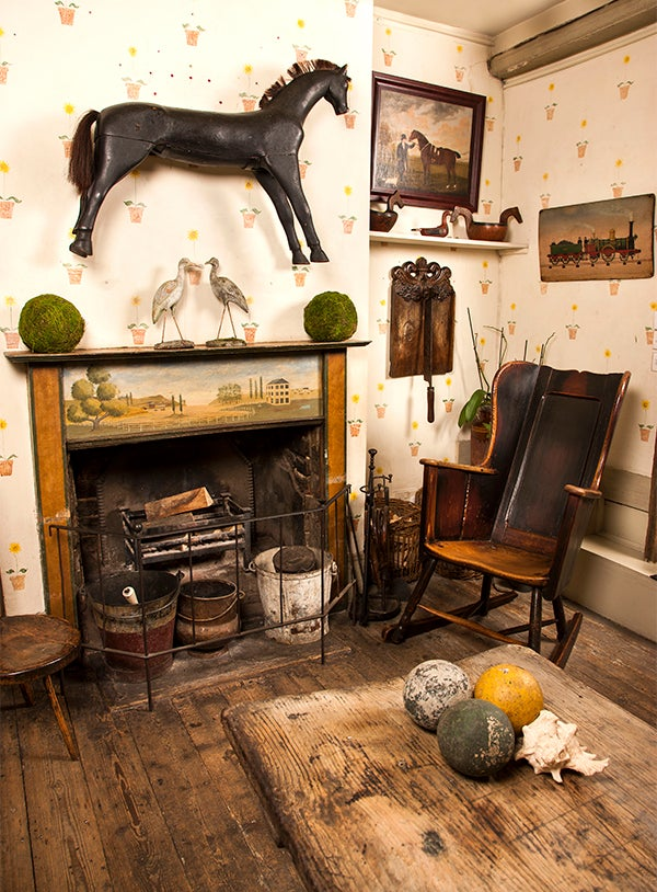 A Well Worn Circa 1800 Wooden Rocking Chair Exemplifies The Kind Of  Primitive Country