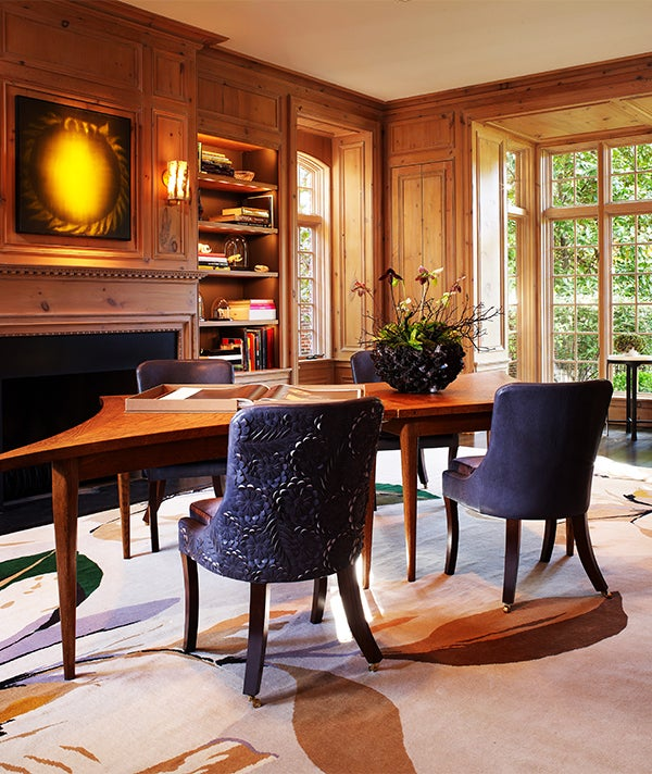 The designer doesn't eschew the traditional altogether: In this Dallas home library, classic wood panelling provides contrast to the contemporary art and carpet by Vivian Westwood for the Rug Company. Photo by Stephen Karlisch