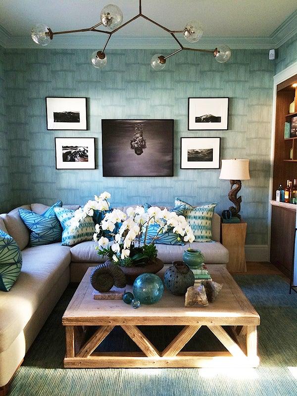 The watery blues of John Bjornen's media room speak to Sag Harbor's seaside setting (photo courtesy of Bjornen Design).