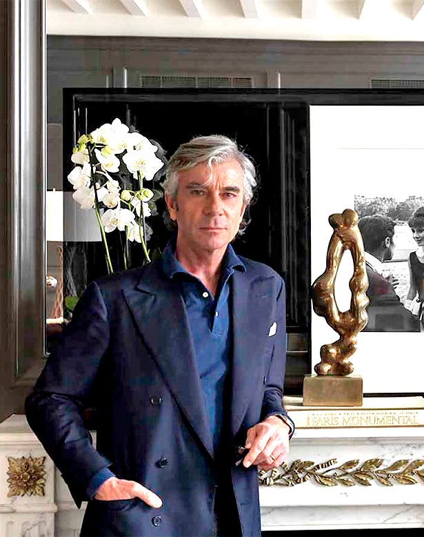 Bönan takes a hands-on approach to his projects, creating the designs for most of the furniture and lighting he includes and personally sourcing the art and antiques. Photo by Massimo Listri; Top:  A classic-contemporary reception room at Florence's Palazzo Tornabuoni, a members-only residence club. Photo courtesy of Michele Bönan