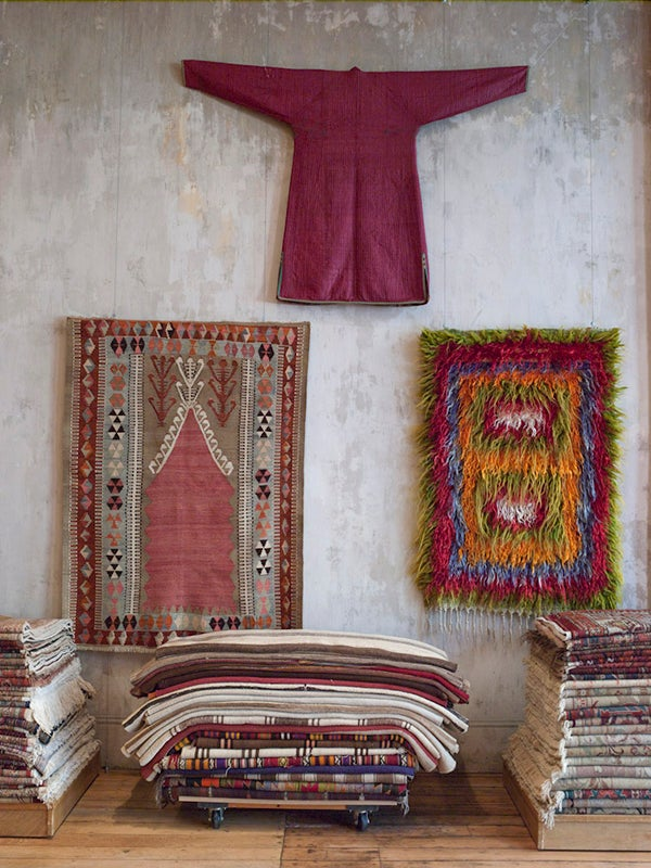 "A 19th-century silk robe from Central Asia; a long-haired ""tulu"" rug in vibrant colors, mid 20th century, Western Turkey; a kilim with a prayer niche design, early 20th century, Central Turkey. Photo by John Gruen"
