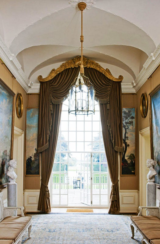 The ornate hallway of an early-18th-century house in England's Northamptonshire embodies the classically English style of author and interior decorator Henrietta Spencer-Churchhill.
