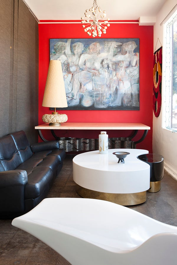 At the Michele Sommerlath space, a De Sede sofa is paired with a Ying & Yang nesting coffee table attributed to Karl Springer. The painting on the back wall is by the Scottish artist Matilda Tumin.