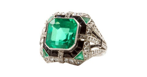 Platinum ring with a 6.11-carat Colombian emerald, diamonds and onyx, 1930s, offered by Jack Weir and Sons