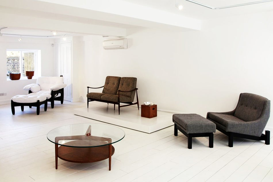 Among The Works On Display In London Are Chairs And Matching Footstools By  Sergio Rodrigues,