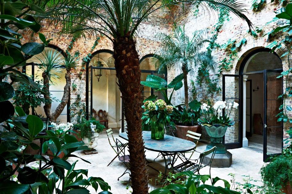The designer's London home opens onto several internal garden spaces.