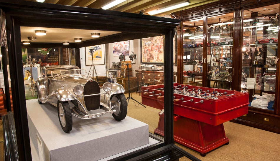 At Pullman Studios, a unique model of the Bugatti Type 41 Royale Coupé Napoléon, by John Elwell, shares real estate with a vintage foosball table.