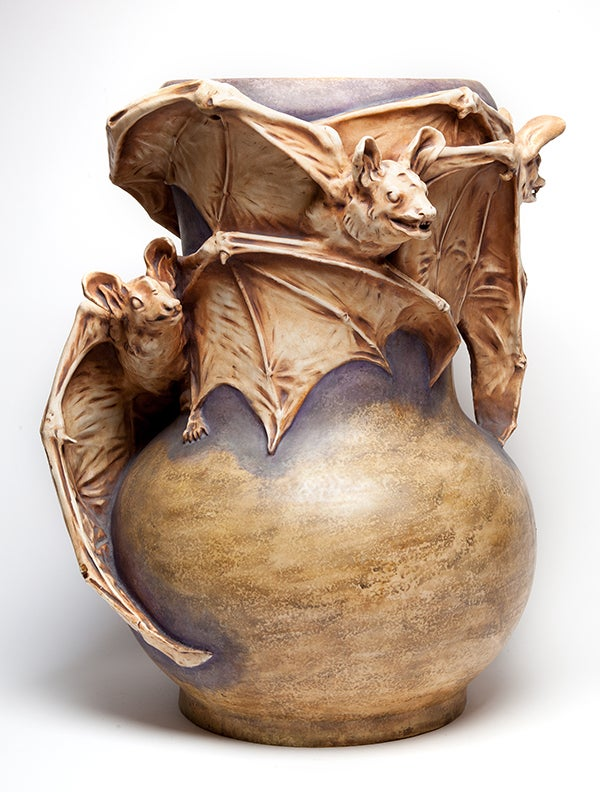 James Infante Monumental Amphora Ceramics Bat Vase. The vase was designed by Eduard Stellmacher in 1901 for the Amphora Ceramics Company also known as Riessner, Stellmacher & Kessel in Turn-Teplitz, Austria. It is Monumental in Scale and extremely rare. Three Applied Bats Wings Extended surround the vase.