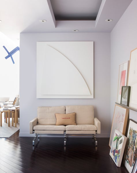 """Says Furth: """"An ever-changing collage of art sets the tone for this contemporary Hollywood home,"""" where an Ellsworth Kelly painting hangs above a sofa by Poul Kjærholm. Photo by Stephen Busken"""