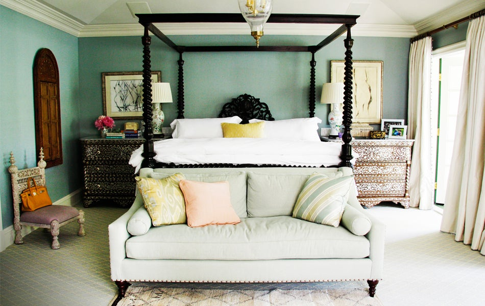 Moroccan chests and an Anglo-Indian bed pair well with de Kooning drawings. Photo by Coleen Rider