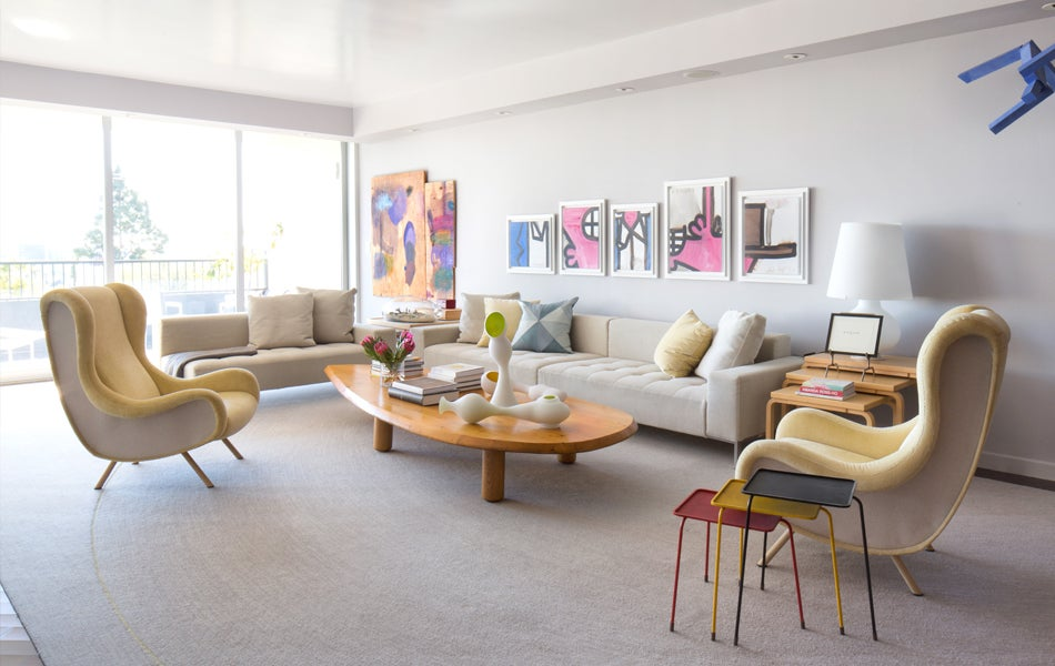 """Lavender walls, Carroll Dunham paintings, Marco Zanuso chairs and glass sculptures by Jeff Zimmerman from R & Company add color and character to what Furth calls a """"rethinking of the modernist white box epidemic."""" Photo by Stephen Busken"""