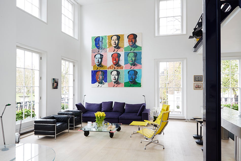 In The Living Area, A Set Of Nine Andy Warhol U201cMaou201d Works Hangs Above A  Poliform Couch, Black Le Corbusier Chairs And Yellow Charles And Ray Eames  Aluminum ...