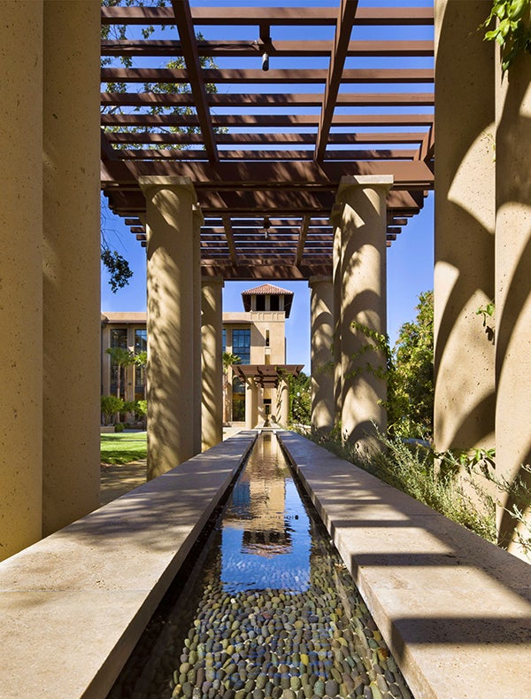 A courtyard with a water feature plays host to social events at the new Stanford Institute for Economic Policy Research (SIEPR).