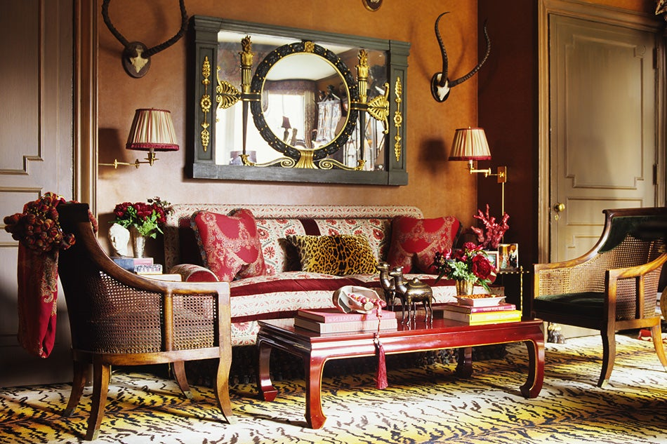 In the library and sitting room of an apartment designed for a Manhattan  bachelor, a Regency mirror  flanked by the client's own hunting trophies   hangs ...