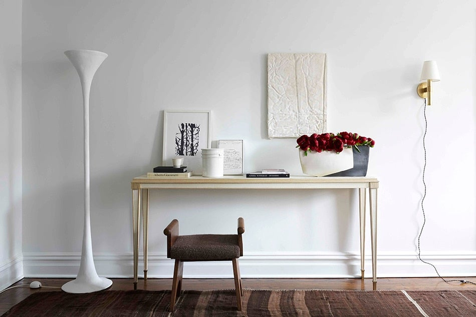 Keep an eye on millennial designer charlie ferrer 1stdibs former chelsea apartment a plaster torchiere by kacper dolatowski from ferrers gallery stands beside a neoclassical parchment console by cotton aloadofball Choice Image