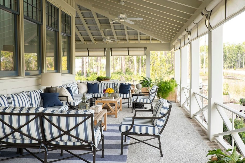 The Sunbrella Fabricu2013upholstered Pair Of Sectionals And Armchairs On The  Porch Are By Suzanne Kasler For Ballard Designs, As Is The Striped Area Rug.