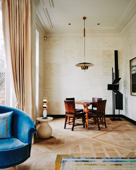 Back in the living room of the Holland Park home, a nook holds a French Art  Deco games table surrounded by Kaare Klint chairs. A ceramic piece by  Ettore ...