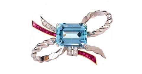 Aquamarine, ruby, diamond, gold and platinum ribbon bow pin, 1940, offered by Dover Jewelry