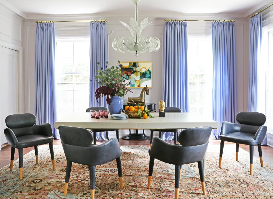 In The Wilmette Homeu0027s Dining Room, Black Leather Chairs Surround A Custom  Table, Which Sits Atop A Mashad Rug From Galerie Shabab.