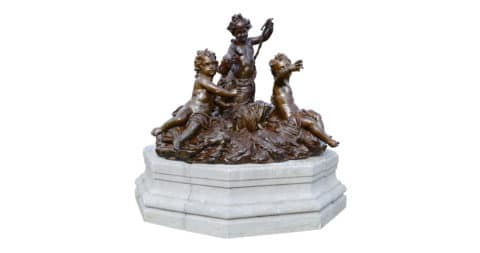 Cast-iron group of putti on granite pedestal, 19th century
