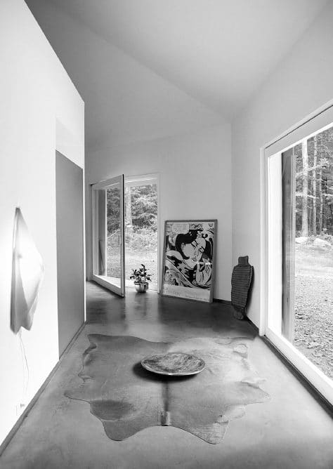 Architect And Interior Designer Angela Pattersons Octagonal Barn Home In Hillsdale New York Features A Wall Mounted Light By Van Nieuwenborg Wegman