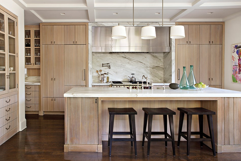 In The Kitchen A Large Circa Bryant Light With An Antique Nickel Finish Hangs Over Wood And Marble Island Photo By Laura Hull