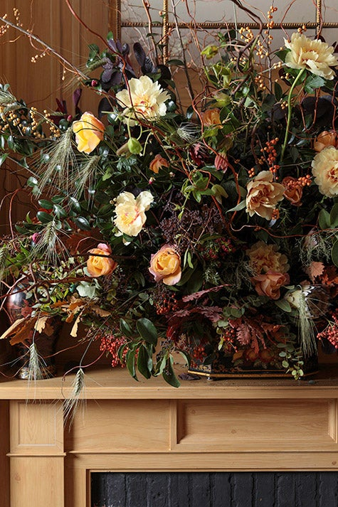 flower arrangement on mantel