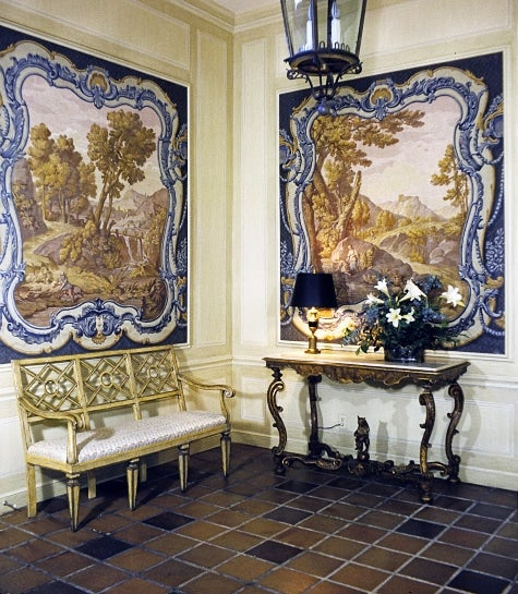 entryway with murals