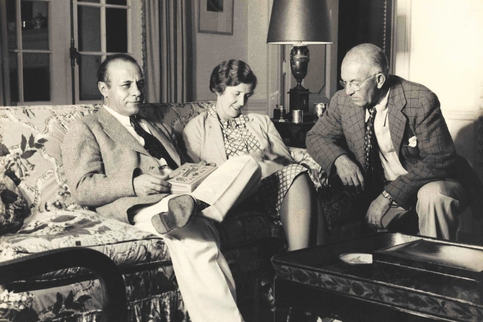 vintage photo of three people sitting together