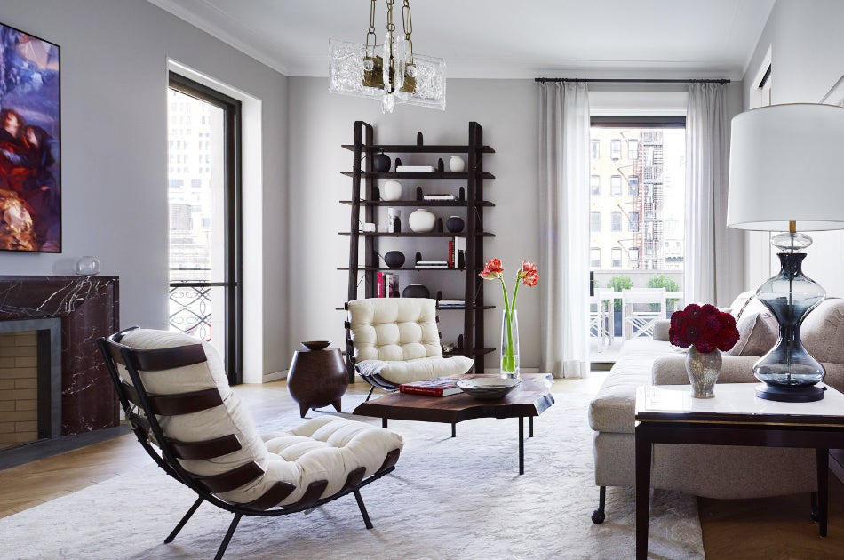 In the living room of an apartment in manhattans west chelsea designer damon liss mixed vintage and contemporary furnishings placing a pair of martin