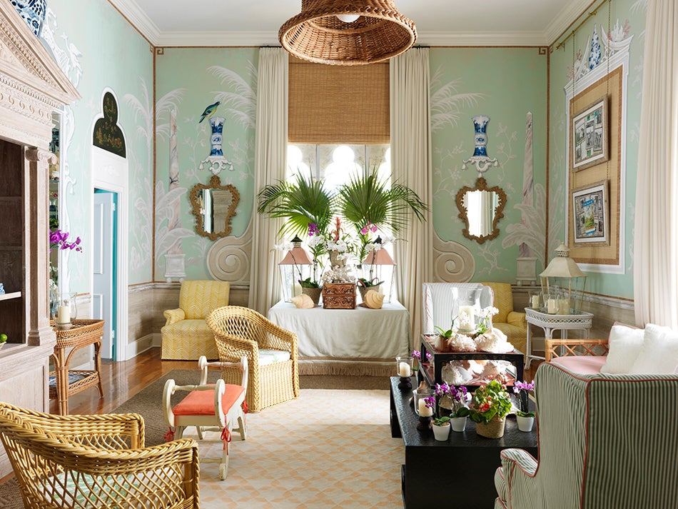 A pair of bielecky brothers rattan chairs adorns the living room of amanda lindroths palm beach home where british artist aldous bertram created the