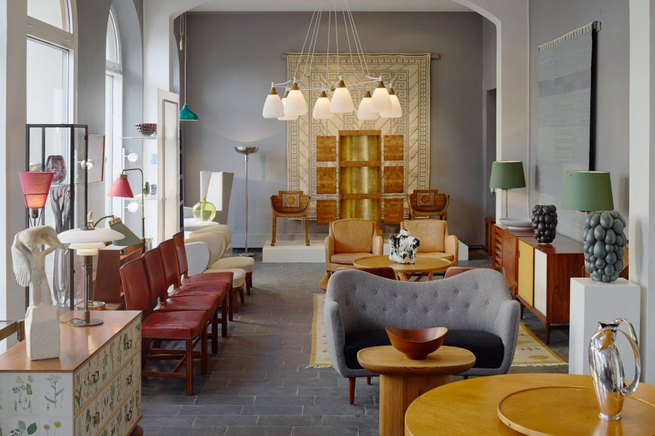 Modernitys stockholm showroom features mid century scandinavian modern furniture and objets the gallery sold the golden cabinet at the back