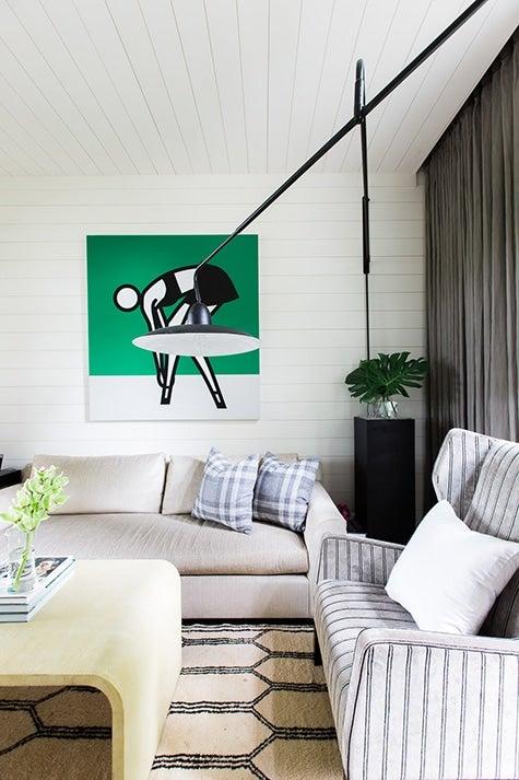 white living room with Julian Opie artwork