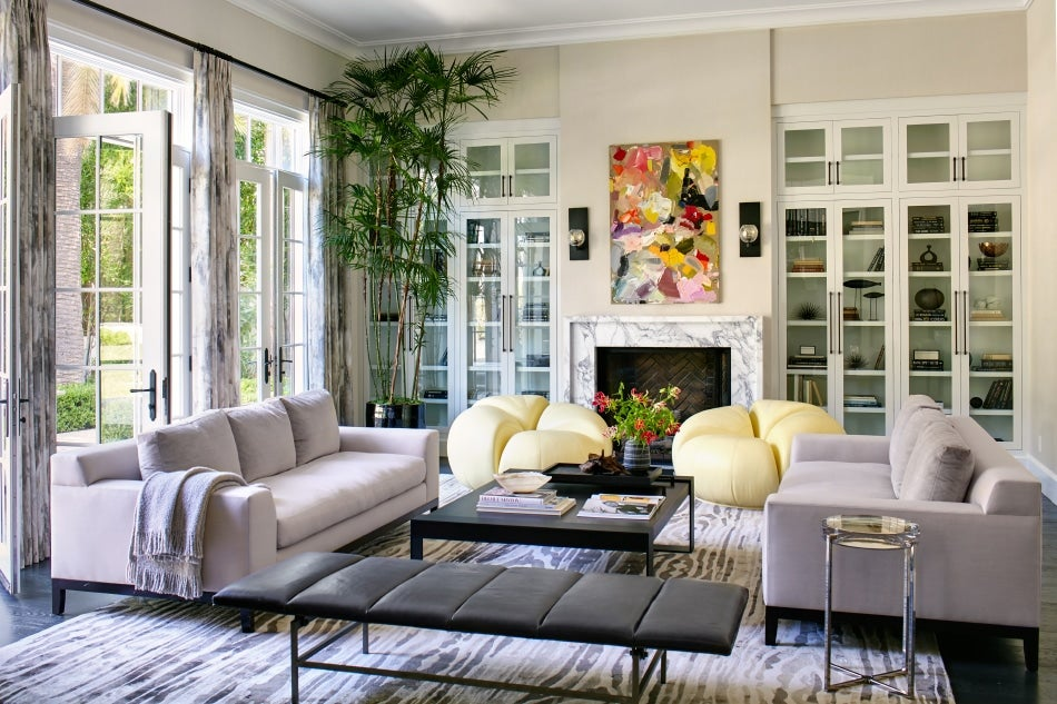 In This Los Angeles Living Room, A Pair Of Blackman Cruz Chairs Covered In  Pale Yellow Leather Sit On Either Side Of The Marble Fireplace.