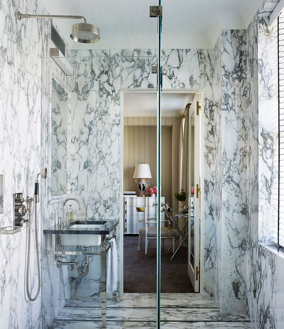 The marble master bathroom designed by David Kleinberg