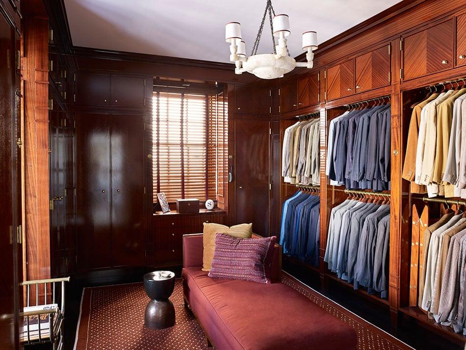 A walk-in closet by David Kleinberg Design Associates