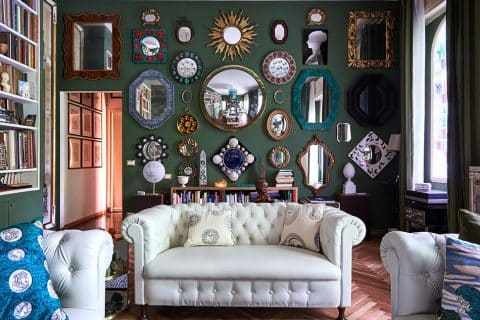 Barnaba Fornasetti's green living room with mirrors