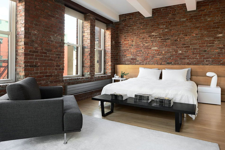 The bedroom, featuring a cedar headboard, in the Chinatown loft