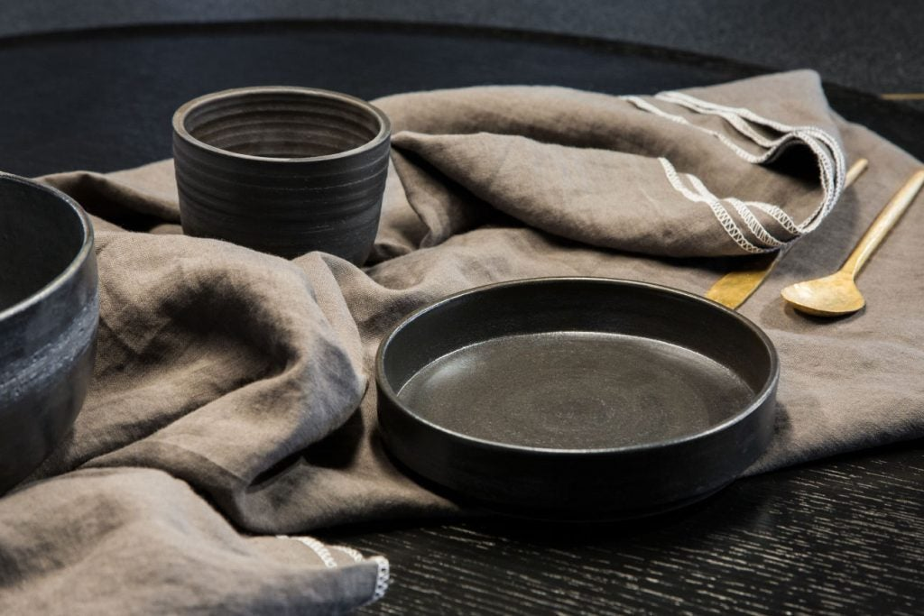 A tablecloth and bowls by Delfina Irigoin