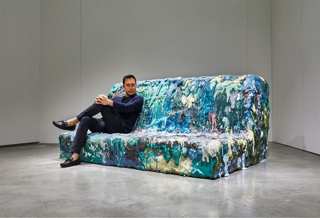 Sang Hoon Kim on his four-person sofa