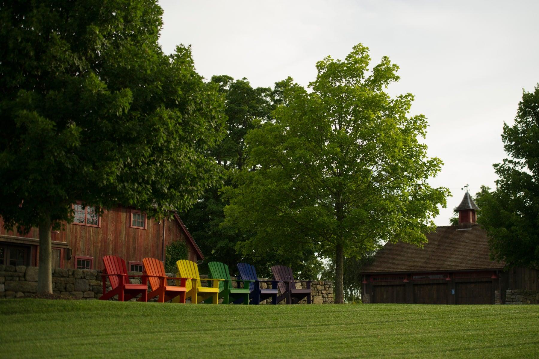 yard with rainbow adirondack chairs