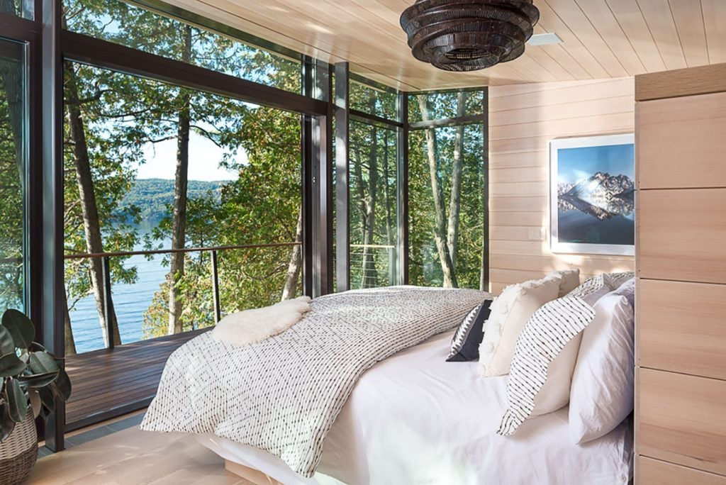 Charlotte Barnes Interiors Bedroom with view of Lake Champlain